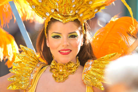 MENTON, FRANCE - 2 MARCH 2014 - Unidentified woman dressed as dancer marching during the parade of the Lemon Festiva