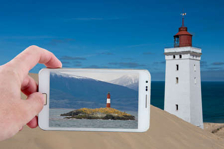 sand dune: Lighthouse on a sand dune in Rubjerg Knude in Denmark and Les Eclaireurs on the Beagle Channel in Ushuaia, Argentina Stock Photo