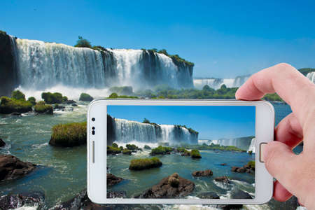 natural wonders: Taking a picture at the footbridge over the magnificent garganta del diablo at the iguazu falls, one of the seven natural wonders of the world Stock Photo