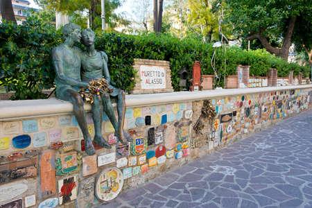 Muretto di Alassio, little wall with its plaques, symbol of Alassio in Liguria Редакционное