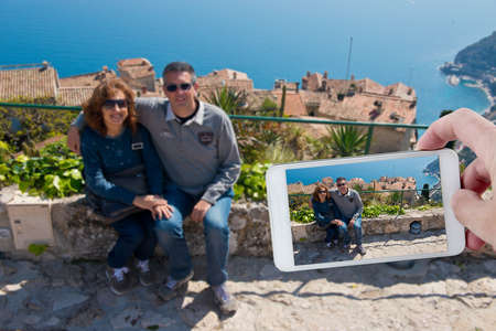 A couple of tourists in Eze, Cote d photo