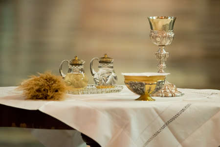 Goblet and ampoules for the offertory of the Communion during the Mass Фото со стока