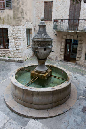 vence: Medieval fountain situated in the charming village of Saint Paul de Vence, Cote d
