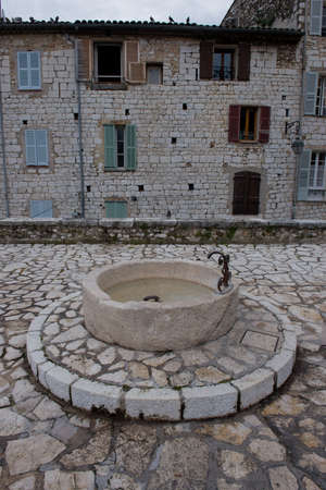vence: Stone fountain in the historical village of Vence, Cote d