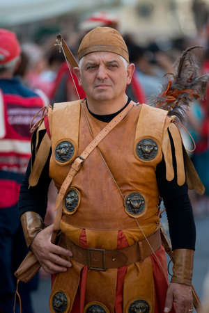 palio: GENOA, ITALY - 8 JUNE  2014 - Unidentified man masked during the historical parade of the Maritime Republics Palio Editorial