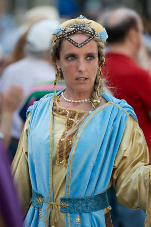 palio: GENOA, ITALY - 8 JUNE  2014 - Unidentified woman masked during the historical parade of the Maritime Republics Palio Editorial