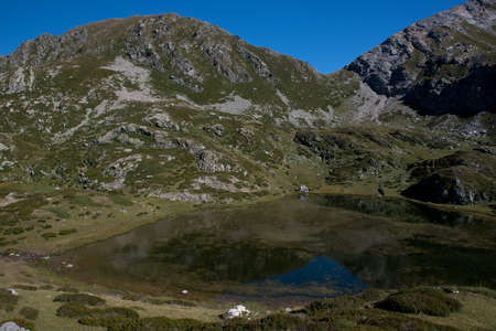 Alpine Brignola Lake situated over 2000m in the Ligurian Alps, near Prato Nevoso in Piedmont, Stock Photo