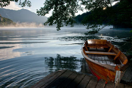 Boat at the pier on the Bled Lake, one the turistical symbols of Slovenia. Stock Photo