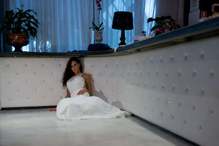 sitted: Young bride laying down on the floor
