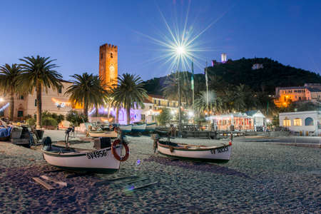 View of the beach of Noli, in the ligurian riviera and its boats