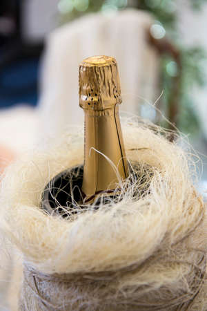 sparkling wine: Bottle of sparkling wine on a wedding banquet table Stock Photo