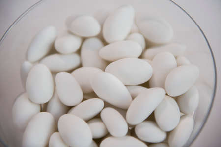 sugared almonds: Sugared almonds on a wedding banquet table Stock Photo