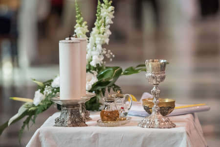 ampoules: Goblet and ampoules of the communion during the mass Stock Photo
