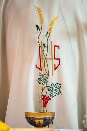 tunic: Priest tunic and the holy bread