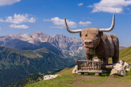 alp: Statue of a Cow near a refuge on the Dolomites