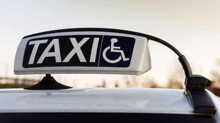 handicapped person: Public car equipped for assistance and transportation for handicapped person