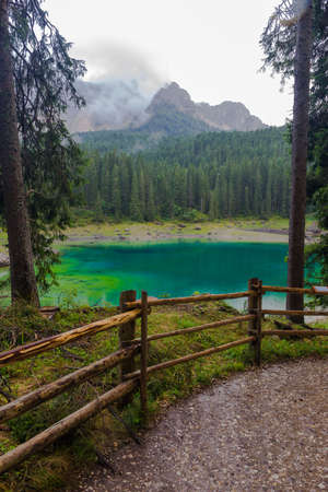 astonishing: The astonishing colours of the water of the Karersee, in Trentino, during a rainy day