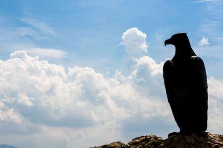 rosengarten: Bronze Eagle as Christomannos Memorial at Karerpass in the Dolomites Stock Photo