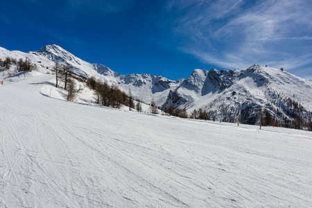 View over the snow-clad slopes of Sestriere in the Milky Way ski resort in Piedmont.