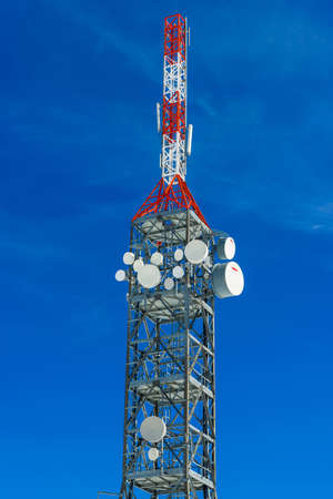 telephonic: Telecommunications tower at the top of the snowy mountain of Val di Susa. Stock Photo