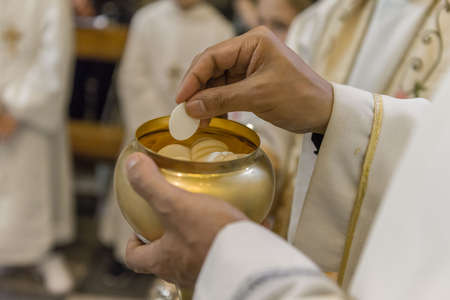 The christian rite of the Communion during the mass