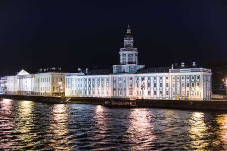 The old town of Saint Petersburg with its landmarks illuminated, seen from the Neva River