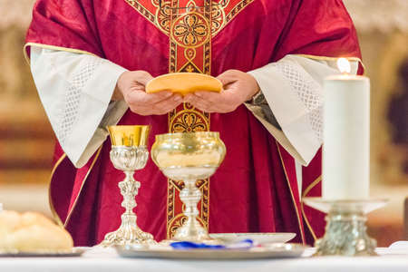 Holy bread rite during the Catholic Mass Фото со стока - 76648946