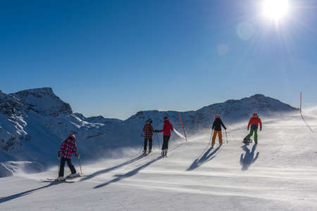Five skiers in Champoluc during winter time.