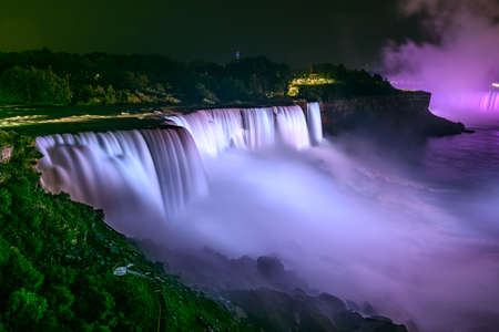 The falls of Niagara illuminated by night