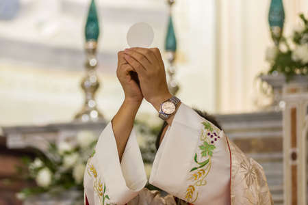 During the christian mass a priest celebrates the rite of the communion