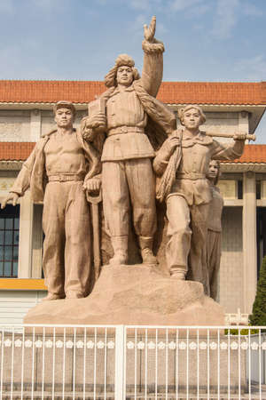Statue representing the Communist People in front of the Mausoleum of Mao in Tienanmen Square, Beijing
