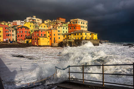 Waves and coastal storm on the fishing village of Boccadasse in Genoa, Liguria Foto de archivo