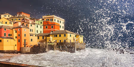 Waves and coastal storm on the fishing village of Boccadasse in Genoa, Liguria Reklamní fotografie