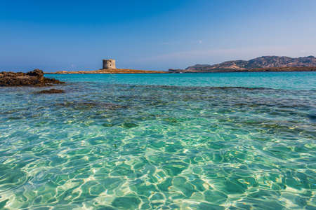 The incredible seewater and the aragonese tower in La Pelosa Beach, Stintino