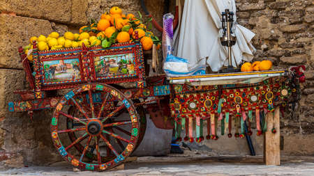 The Sicilian cart is an ornate, colorful style of horse or donkey-drawn cart native to the island of Sicily, in Italy. Archivio Fotografico