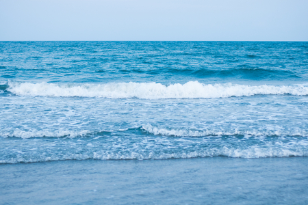 blue soft wave with clean ocean . sun light on sea . travel to the beach on summer holiday . 版權商用圖片