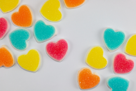 colorful jelly sweet heart shape . sugar yummy candy on white background for valentine day .