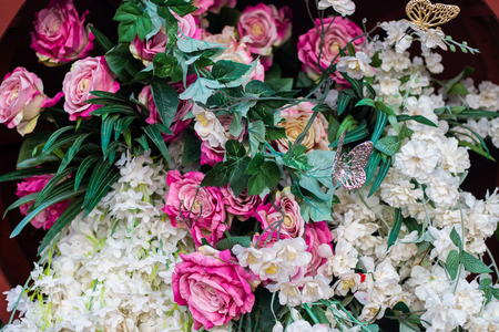 fresh rose flowers bouquet decoration in natural garden , beautiful background for wedding ceremony . exotic various type of bundle blossom . romantic scenic .