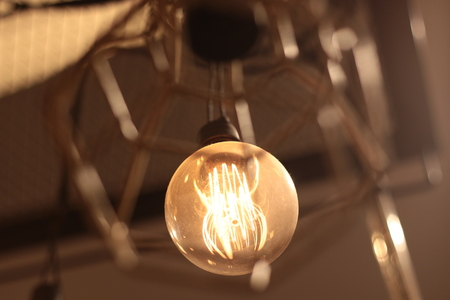 A electric lamp lighting . modern and vintage style , interior ceiling hanging light bulb decorate at room
