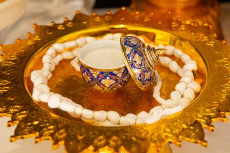 Thai Benjarong and Mong Kol and Sachet powder on gold pedestal tray , Thai art design style .