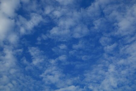 blue sky and white cloudy , beautiful heaven scene , Altocumulus pattern texture background . Stock Photo