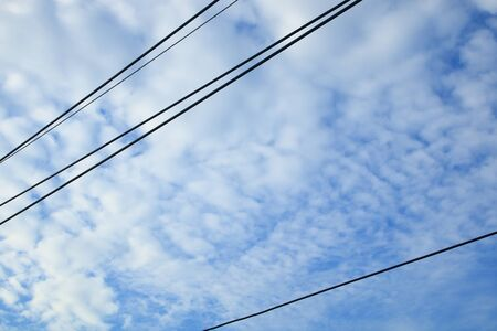 wires line , blue sky and white alto cumulus cloudy .