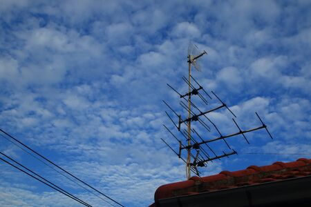 blue sky and cloudy , cable wire line and antenna electricity television digital transmission .