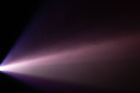beautiful purple pantone color wide lens projector light beam . smoke abstract texture . screening for multimedia . black background .