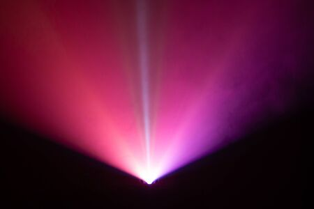 beautiful color wide lens projector light beam for movie and cinema at night . smoke texture spotlight . screening for multimedia . black background . Stock Photo