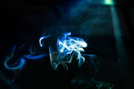 blur blue smoke abstract texture in the air .