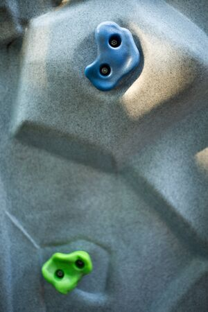 cliff climbing wall extreme activity background , indoor hobby and sport . Stockfoto - 126009271