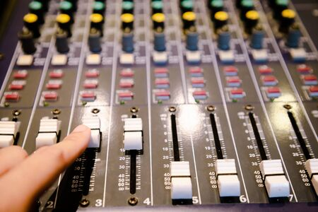 sound mixing control , close up texture and pattern of music panel electric instrument . entertainment professional machine set .