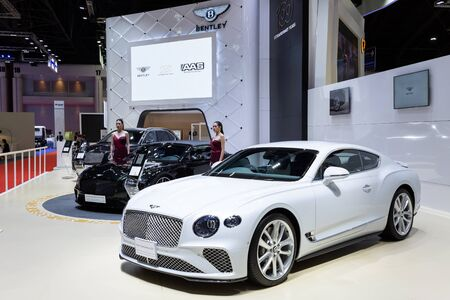 Nonthaburi , Thailand - April 3, 2019: The New Bentley Continental GT suv luxury sport car and beautiful pretty girl presented in motor expo .