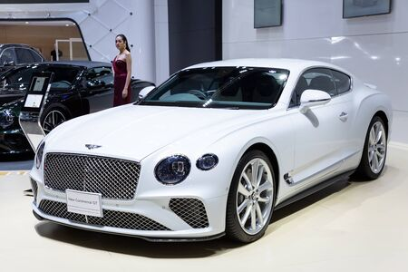Nonthaburi , Thailand - April 3, 2019: The New Bentley Continental GT luxury sport car and beautiful pretty girl presented in motor expo Thailand .
